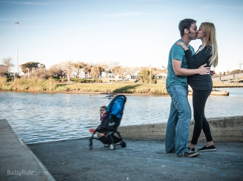 Couple kissing and baby falls to water